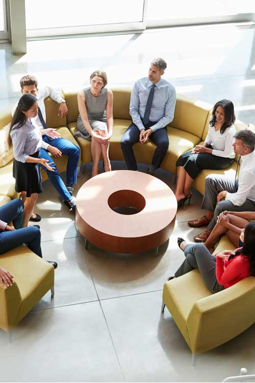corporate-wellbeing-meeting-in-a-business-lounge-area-